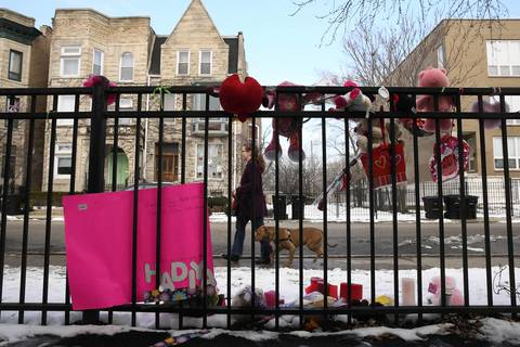 A memorial for Hadiya Pendleton, who was killed at Harsh Park on Oakenwald, adorns a fence in the Kenwood neighborhood of Chicago.