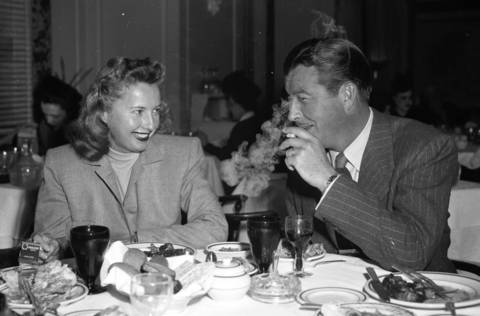 Barbara Stanwyck and her husband Robert Taylor, who stopped at the Boston Oyster at the Morrison Hotel. Feb. 1, 1947. Stanwyck was a very successful actress, making 93 movies in her career. In 1944 she was the highest paid woman in the United Sates. Stanwyck and Taylor's marriage ended in 1950, but Stanwyck said Taylor was the love of her life. (sidenote: The Morrison Hotel was the tallest building outside of New York City to have more than 40 floors. It was razed in 1965, the Chase Tower now stands in its place.)