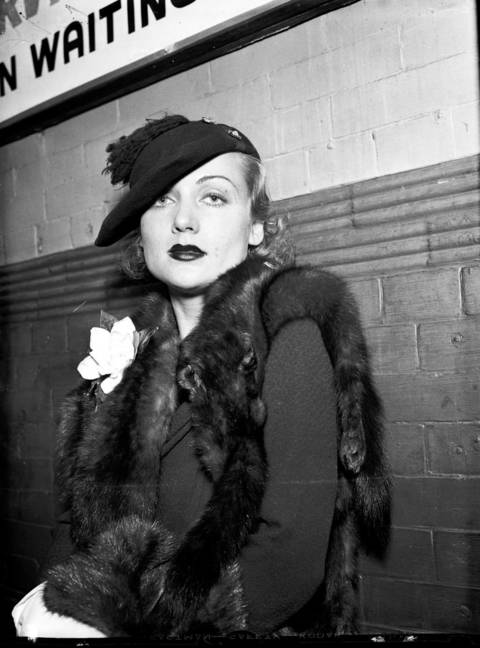 Actress Carole Lombard in Chicago, September 15, 1934. The most successful actress of the 1930s, Lombard was also famous for her marriage to actor Clark Gable in 1939. Lombard died tragically in 1942 in a plane crash. She was returning home from a war bond rally in her home state of Indiana with her mother, and Gable's agent (and close friend) Otto Winkler. She is interred in California under the name Carole Lombard Gable, and Clark Gable is beside her.