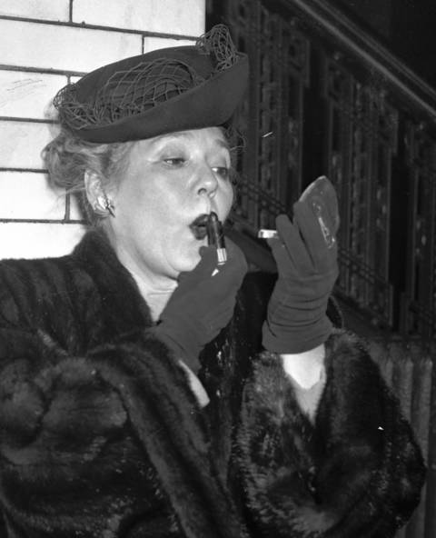 Mary Pickford applies lipstick at LaSalle Station, Feb. 13, 1947. One of the greatest actresses of all time, Pickford is part of the original 36 founders of the Academy of Motion Picture Arts and Sciences.