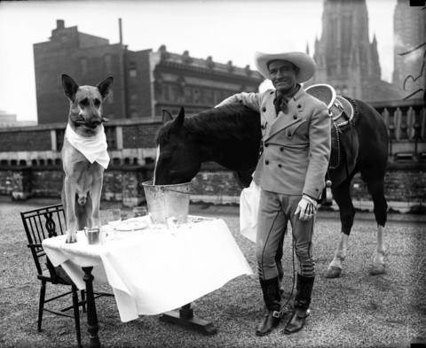 Movie stars Flash the dog, eating dinner with Tony the horse and Western film actor Tom Mix, April 26, 1929. Mix was the first Western megastar and helped define the genre. He made 291 films between 1909-35, and all but nine were silent films.