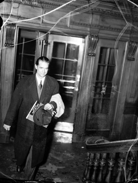 Business man, aviator and film maker Howard Hughes walks into a hotel, Jan 24. 1937. (Hughes was dating Katharine Hepburn at that time)