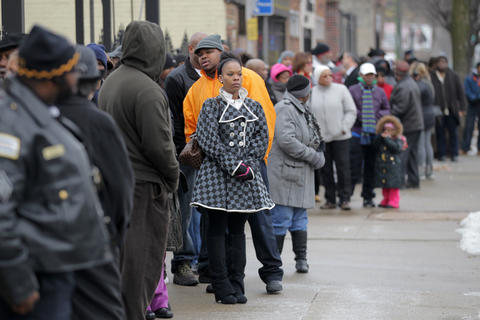 Mourners line up to attend the wake for 15-year old Hadiya Pendleton at Calahan Funeral Home on Friday afternoon.