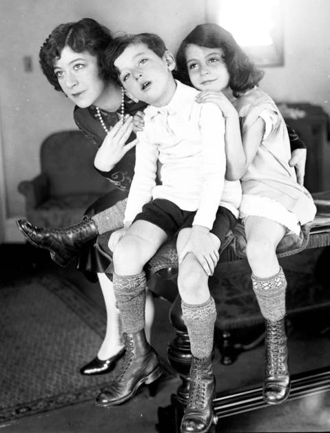 "Fannie Brice and her children, Frances and William, November 13, 1925. Frances and William's father was professional gambler Nicky Arnstein. Brice stood by Arnstein as he served time at Sing Sing Prison, only to be abandoned by him upon his release in 1927. Brice was a Ziegfeld Follies girl and perhaps best known for her role as Baby Snooks, She was later portrayed by famed actress Barbra Streisand in ""Funny Girl,"" a movie produced by daughter Frances' husband Ray Stark."