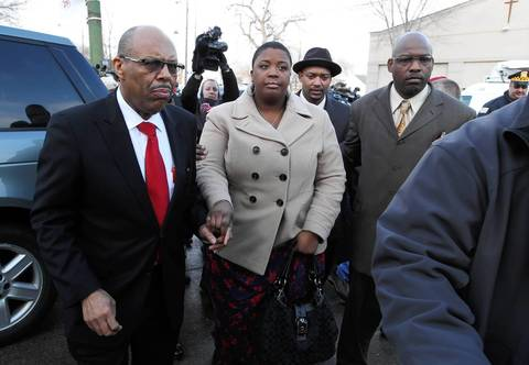Cleopatra Cowley-Pendleton, center, arrives at the visitation for her 15-year-old daughter Hadiya Pendleton at Calahan Funeral Home located at 7030 S. Halsted St. in Chicago