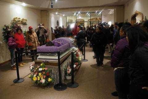Mourners view the body of 15-year-old Hadiya Pendleton at Calahan Funeral Home in Chicago. A White House official said Michelle Obama will attend Saturday's funeral for Pendleton.