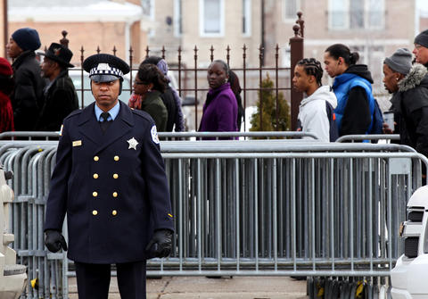 A Chicago Police officer stands in front of the visitation line before Hadiya Pendleton's funeral on Saturday morning.