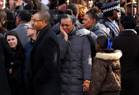 Mourners gather outside the Greater Harvest Baptist Church in the Washington Park neighborhood before the funeral for 15-year-old Hadiya Pendleton on Saturday.