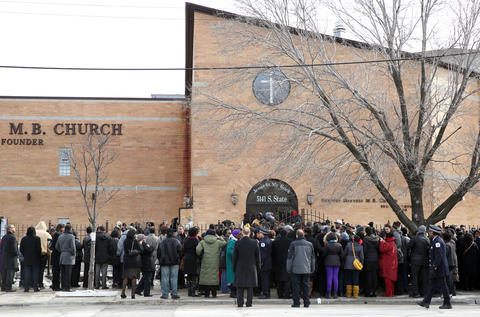 People crowd around the entrance to the Greater Harvest Baptist Church for the funeral of Hadiya Pendleton on Saturday. Dozens were turned away after the church reached capacity.