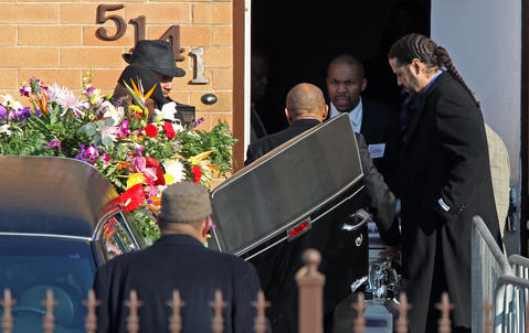 The casket of Hadiya Pendleton is moved into a hearse at the Greater Harvest Baptist Church in Chicago on Saturday.