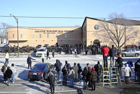 Guests exit the Greater Harvest Missionary Baptist Church after the funeral of Hadiya Pendleton.