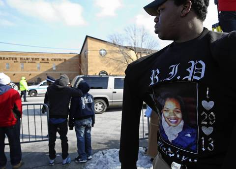 King College Prep student Andrew Mason, 15, wears a sweatshirt in honor of Hadiya Pendleton outside the Greater Harvest Missionary Baptist Church during her funeral.