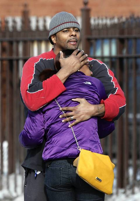 People comfort each other outside the Greater Harvest Missionary Baptist Church during the funeral of Hadiya Pendleton.