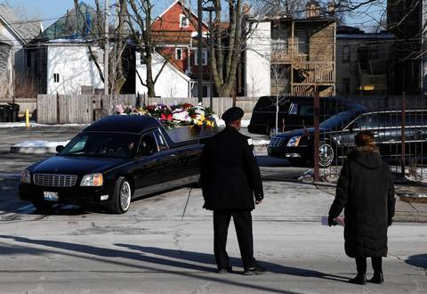 The hearse carrying Hadiya Pendleton leaves Greater Harvest Baptist Church, after her funeral service.