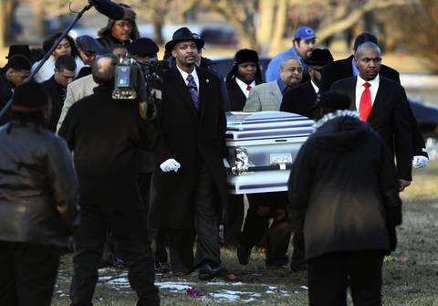 Pallbearers carry the casket containing the body of Hadiya Pendleton to her burial site at Cedar Park Cemetery in Riverdale.