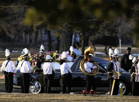 King College Prep band members play as the hearse carrying the body of Hadiya Pendleton arrives at Cedar Park Cemetery in Riverdale.