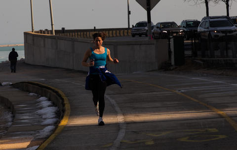 Runners on the Chicago lakefront rail enjoy warmer weather on Wednesday.