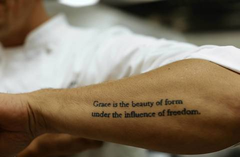 Months before the completion of Grace, chef Curtis Duffy had tattooed the name and meaning of grace on his left arm.