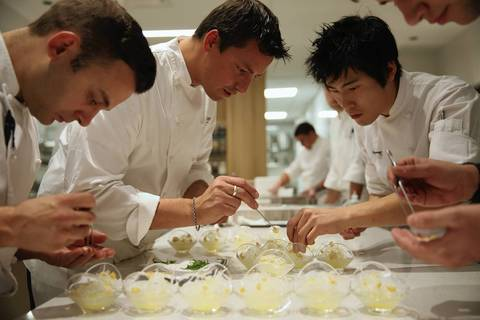 Chef de cuisine Nicholas Romero, left, chef Curtis Duffy and sous chef Dan Bark decorate a dessert during a practice run at Grace.