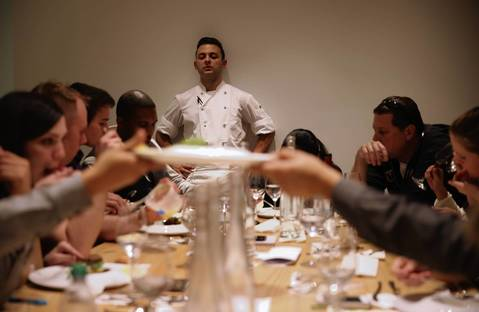 Chef de cuisine Nicholas Romero takes questions from the serving staff during a practice run at Grace less than two weeks before opening night.