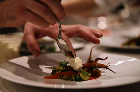 Chef Curtis Duffy tests a dish before the opening night of his new restaurant Grace.