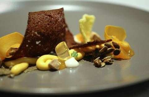 The Mandarin pumpkin dessert with pine nuts, star anise, caramelized pumpkin seeds, pumpkin cream and yogurt sorbet.