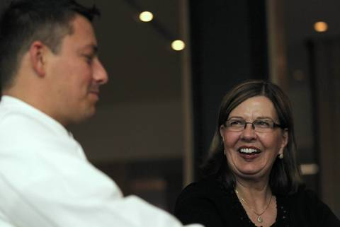 Chef Curtis Duffy and his high school home economics teacher, Ruth Snider, share a few minutes after dinner during opening night at Grace.