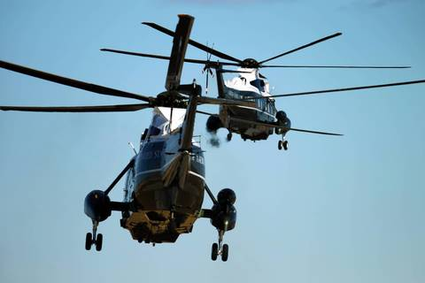 Marine One and a second helicoptor depart O'Hare International Airport, bound for downtown Chicago with President Barack Obama on board.