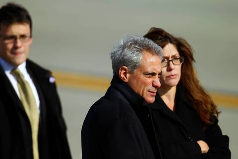 Chicago Mayor and former White House chief of staff Rahm Emanuel waits for President Barack Obama to land in Air Force One at O'Hare International Airport in Chicago.