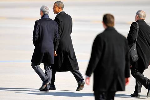 President Barack Obama talks with his former chief of staff and Chicago Mayor Rahm Emanuel after landing at O'Hare International Airport .