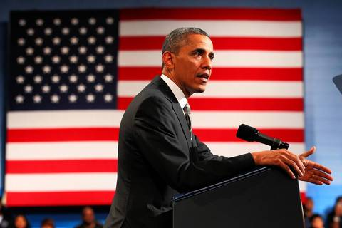 President Barack Obama visits Hyde Park Academy in Chicago to discuss proposals unveiled in his State of the Union speech that focus on gun violence and strengthening the economy for the middle class.
