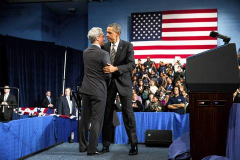 President Barack Obama is welcomed by Mayor Rahm Emanuel at Hyde Park Academy in Chicago. Obama delivered an address on gun violence and strengthening the economy for the middle class.