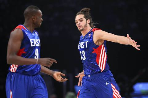 Joakim Noah celebrates with Luol Deng in the first half.
