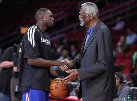 Luol Deng talks with NBA legend Bill Russell before the game.