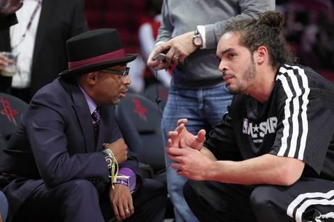Director Spike Lee and Joakim Noah talk before the game.