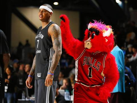 Benny the Bull goes to grab the headband of the Knicks' Carmelo Anthony during All-Star practice.