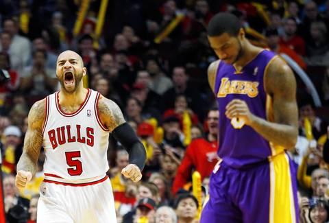 Carlos Boozer reacts after a missed shot by the Lakers' Earl Clark during the second half.