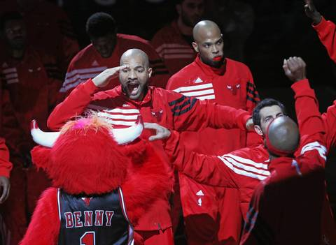 Carlos Boozer salutes Benny The Bull after intros before a preseason game against the Grizzlies.
