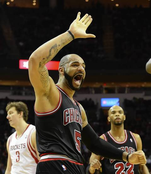 Carlos Boozer reacts after a teammate scored and was fouled against the Rockets in the second half.