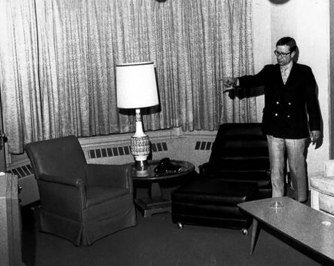 Gene E. Tyhurst, Vice President of the St. Nicholas Hotel, points to the bedroom area of room 546, the suite occupied by former Secretary of State Paul Powell. The executer of Powell's estate, Dr. John Rendleman, announced he found more than $800,000 in the hotel room following the secretaries death.