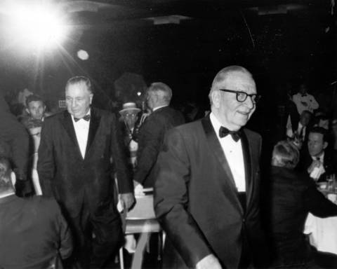 Chicago Mayor Richard J. Daley, left, and Illinois Secretary of State Paul Powell, right, are in the spotlight as they enter a dinner in honor of Powell on June 14, 1968, while Powell served as secretary of state.
