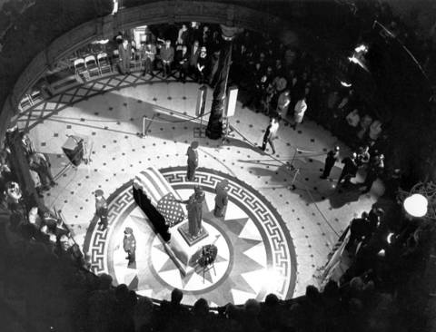 The body of Secretary of State Paul Powell lies in state in the capital rotunda on October, 13, 1970 as mourners gather to eulogize and pay their respects to the former political leader. Powell was then buried in Vienna, Illinois.