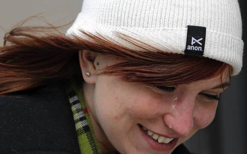 A tear drops from the eye of DePaul University student Sam Henning as she is hit by a stiff breeze on West Wacker Drive. Tears protect eyes from drying out in cold, windy weather.