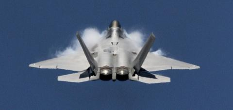 Vapor forms on the wings as an F-22 Raptor prepares to go vertical during a flight demonstration at Langley Air Force Base Monday.