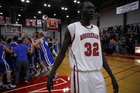 Mooseheart's Makur Puou walks off the court following his team's 70-67 loss to Chicagoland Jewish during IHSA Class 1A sectional semifinal.