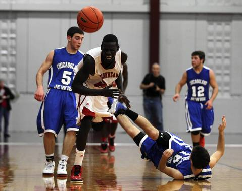 Mooseheart's Mangisto Deng reacts after colliding with Chicagoland Jewish's Avidan Halivni during Mooseheart's 70-67 loss in IHSA Class 1A sectional semifinal.
