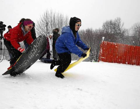A declared snow holiday brought these girls to the snowy slopes of Rotary Hill Naperville.