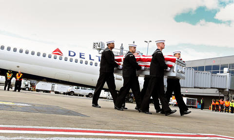 Members of the U.S. Navy Ceremonial Guard take the remains of a USS Monitor sailor to a hearse after they arrived at Dulles International Airport Thursday morning during a Dignified Transfer Ceremony. The two sets of remains will be laid  to rest in Arlington National Cemetery Friday with full military honors. No Mags, No Sales, No Internet, No TV