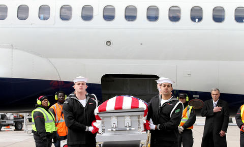 Members of the U.S. Navy Ceremonial Guard move the remains of a sailor killed when the USS Monitor sank of the North Carolina coast. The two sets of unidentified remains will be laid to rest in Arlington National Cemetery on Friday. No Mags, No Sales, No Internet, No TV