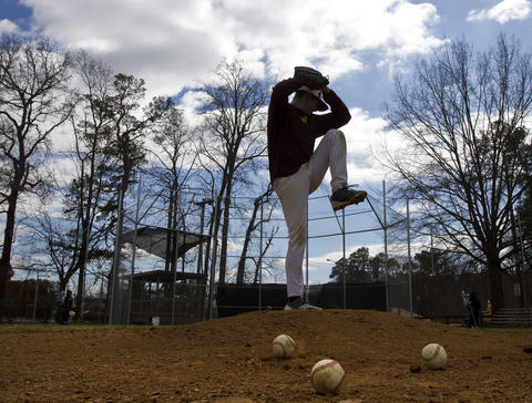 Warwick High School senior Dallas Bevins throws a pitch during practice on Friday afternoon. A new VHSL rule limits the innings a pitcher can pitch in a given time frame. Warwick coach Todd Barker says this means his starters will likely throw one game per week.